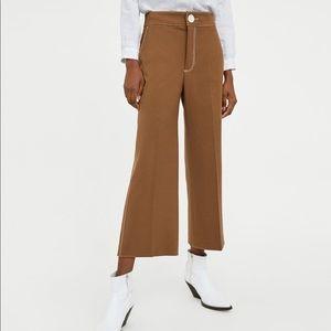 Zara tan pants with white stitching